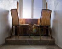 De stoelen van de rotan op zonsopgang Royalty-vrije Stock Afbeelding