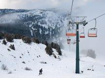 De stoelen van de skilift Stock Foto