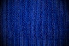 De stof van de textuur van donkerblauwe kleur. horizontaal Stock Afbeeldingen