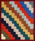 De stoffenpatroon van het tapijt met geometrisch ornament Stock Foto's