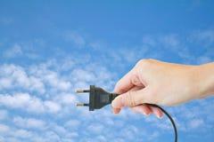 De stop van de macht in een hand Stock Foto