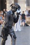 De straatuitvoerder van het cowboy levende standbeeld Stock Foto