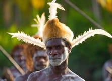 De strijder van Portretasmat met het traditionele schilderen en het kleuren op een gezicht Stock Foto
