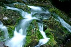 De Stromen van het water stock afbeeldingen