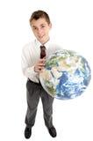 De student die van de school de wereld in zijn handen houdt royalty-vrije stock afbeeldingen