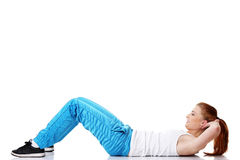 De student die van de tiener oefeningen op de vloer doet. Stock Foto's