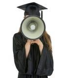 De student van de graduatie het spreken megafoon in camera Stock Foto