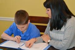 De Student van het tutoring Stock Afbeeldingen
