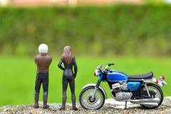 De stuk speelgoed motorfietsminnaar Stock Fotografie