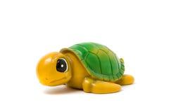 De stuk speelgoed schildpad op een witte achtergrond Stock Foto