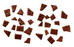 De stukken van de chocolade op wit Stock Foto's