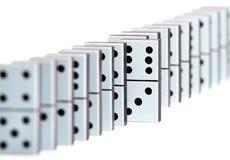 De stukken van de domino in een lijn Stock Afbeelding