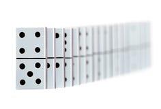 De stukken van de domino in een lijn Royalty-vrije Stock Afbeeldingen
