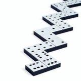 De stukken van de domino in een lijn of een zigzag Stock Afbeelding