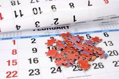 De Stukken van de puzzel op Kalender Stock Foto's