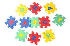 De stukken van het alfabetraadsel Stock Afbeelding