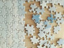 De stukken van de puzzel Stock Afbeeldingen