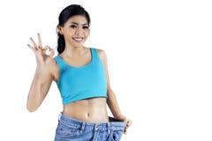 De succesvolle vrouw verliest gewicht Stock Fotografie
