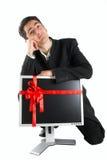 De succesvolle zakenman koopt monitor. Stock Foto's