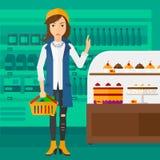 De supermarktmand van de vrouwenholding Royalty-vrije Stock Afbeeldingen