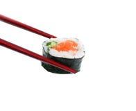 De Sushi van de holding Stock Afbeeldingen