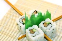 De Sushi van het broodje die over wit worden gestructureerd royalty-vrije stock afbeeldingen