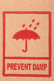 De symbolen van de veiligheid op karton Royalty-vrije Stock Foto