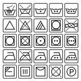 De symbolen van de wasserijzorg Textielzorgpictogrammen Stock Foto's