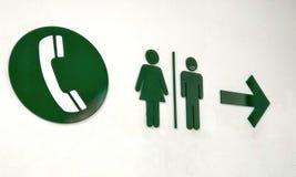 De symbolen voor gaan naar toiletten en telefoongebied in internationale luchthavens royalty-vrije stock fotografie