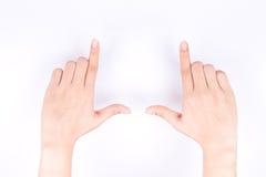De symbolenconcept van de vingerhand het ontwerpen samenstelling voor het nemen van een foto op witte achtergrond Stock Foto's