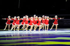 De synchro Glanzende Bladen van ijsschaatsers Stock Afbeeldingen