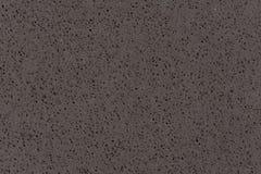 De synthetische textuur van de kwartssteen, donkere grijze toon Royalty-vrije Stock Foto
