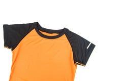 De t-shirt van vrouwensporten op een witte achtergrond stock foto