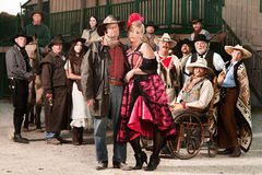 De taaie Oude Cowboy en de Prostituee van het Westen royalty-vrije stock afbeelding