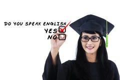 De taalvrijgezel schrijft op whiteboard 1 Stock Fotografie