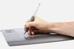 De tablet & de hand van de grafiek Stock Afbeelding