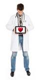 De tablet van de artsenholding - Rood hart Stock Afbeeldingen