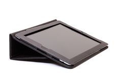 De tablet van Internet in zwarte leerdekking royalty-vrije stock afbeeldingen