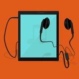 De tablet wordt verbonden aan oortelefoons Stock Foto