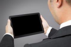 De tabletPC van de bedrijfsmensenlezing Stock Foto