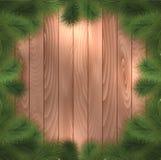 De takken van de kerstboom op hout Royalty-vrije Stock Foto's