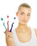 De tandenborstels van de vrouw Stock Foto