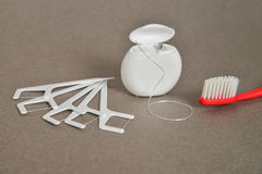 De tandreeks van het Hygiënehulpmiddel: zijde en tandenborstel Stock Afbeeldingen