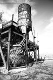 De tank van het water in een verlaten spookstad Stock Foto's