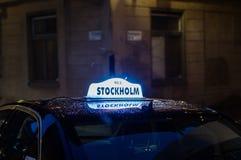 De taxiteken van Stockholm Stock Foto's
