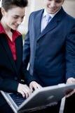 De technologie van Businesspeople stock fotografie