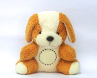 De teddybeer is bruin en wit, leuk en recht met een cirkel voor het bericht stock foto