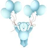 De teddybeer die van de babyjongen houdend ballons vliegen Royalty-vrije Stock Afbeeldingen
