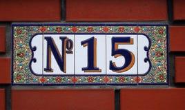 De tegelplaque van het huisnummer met bloemenornament Royalty-vrije Stock Fotografie