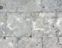 De tegels van de steenvloer met de barst Stock Foto's